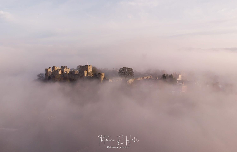 Ludlow Castle in the morning mist